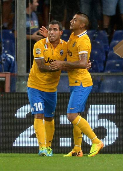 Tevez e Vidal - Getty Images