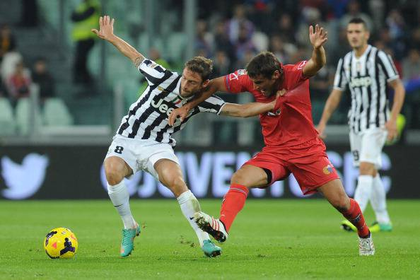 Bergessio in contrasto con Marchisio - Getty Images
